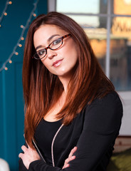Intellectual Business Woman Wearing Glasses Head Tilted