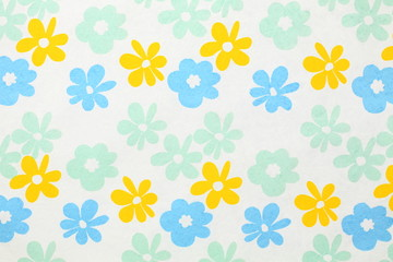 White paper with red, blue and green flowers for background