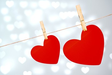 Wall Mural - Composite image of hearts hanging on a line