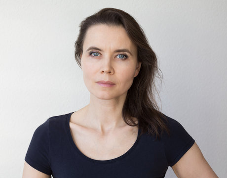 Serious woman looking into camera