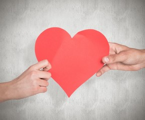 Wall Mural - Composite image of hands holding red heart