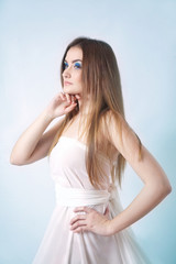Beauty young woman in white dress