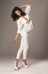 young beautiful caucasian brunette in white clothes