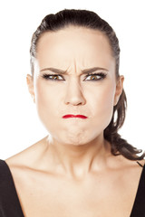 young woman making a very angry face