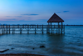 Wooden bridge to the tropical beach in the Thai's island