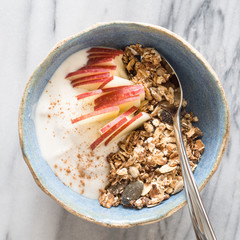 A Bowl of  Granola with Apple Slices, Yogurt and Cinnamon