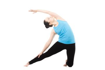 Yogi female in yoga asana Parighasana