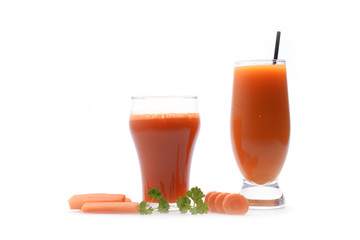Carrot juice and slices of carrot on white