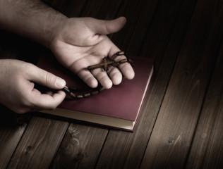 cross in the hands of