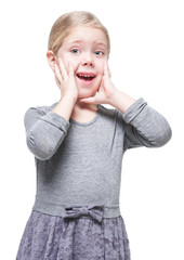 Beautiful little girl with blond hair surprised isolated