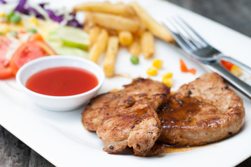 Succulent thick juicy portions of grilled fillet steak served wi