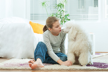 Little girl talking with her pet