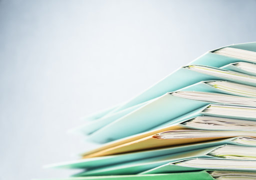 Files.Pile of document close up shot.