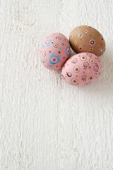 Easter eggs on a white wooden background, text space