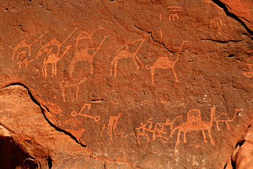 rock paintings on the red rocks of Wadi Rum desert in Jordan