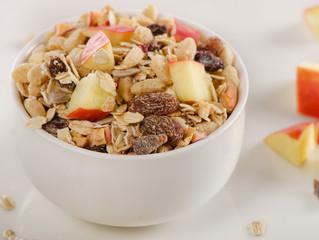 Healthy muesli breakfast with a apple