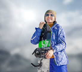 Woman with snowboard on the sky background