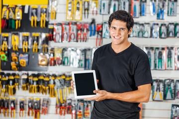 Man Displaying Digital Tablet In Hardware Store