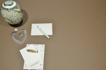 Writing a letter, a map and a brown background