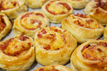rolled baking of puff-paste with cheese and ham