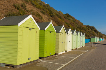 Green beach huts traditional English structure