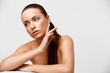 Spa Woman. Beautiful Girl Touching Her Body. Perfect Skin.