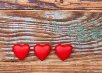 Red hearts on grunge wooden background