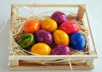 Interestingly colored Easter eggs in a box