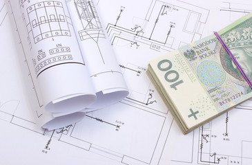 banknotes and electrical diagrams on construction drawing