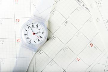 カレンダーと腕時計のスケジュールのイメージ