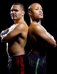 black boxer posing with latino opponent on a black background
