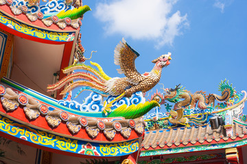 Swan and dragon sculpture decorate on the roof.
