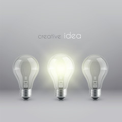 creative idea solution symbol with burning light bulb