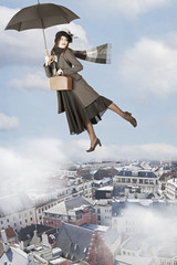 Mary Poppins flies over the city