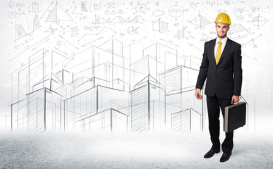 Handsome construction specialist with city drawing in background