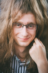 Portrait Of Hippie Hippy Young Man Guy With Glasses And Long Hai