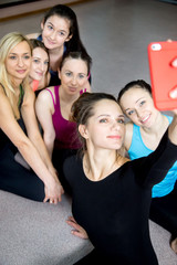 Group of beautiful sporty girls posing for selfie, self-portrait