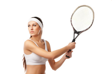 Adult woman playing tennis.
