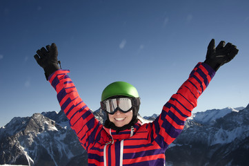 Woman raising her arms expressing happiness