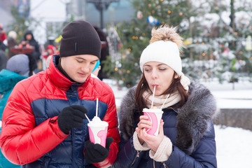 Young Sweethearts with Winter Cup Drinks