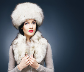 Portrait of a young and beautiful lady in winter clothes