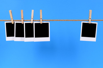 Blank instant photo prints on a rope