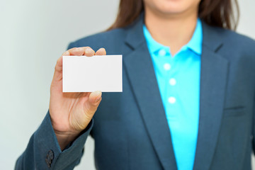 Business woman holding blank name card