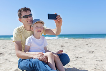 family taking selfie at the beach