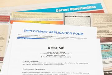 Resume on classify newspaper concept job applying