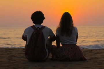 Young Couple is Watching Sunset