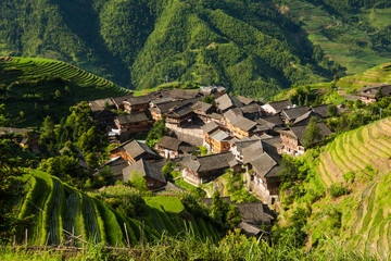 Spoed Fotobehang China Landscape photo of rice terraces and village in china