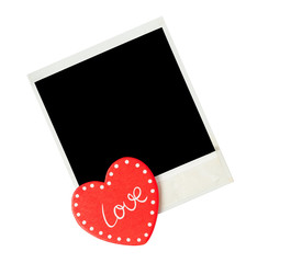 Empty polaroid photo frame with heart  for valentines day on iso