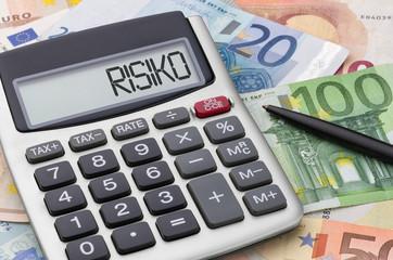 Fotomurales - Taschenrechner mit Geldscheinen - Risiko