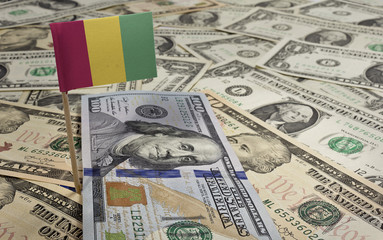 Flag of Guinea sticking in various american banknotes.(series)